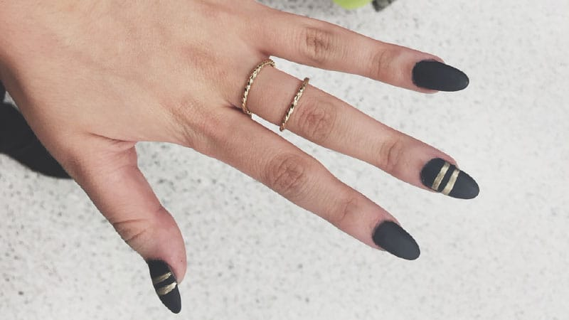 Black and Gold Almond Shaped Nails
