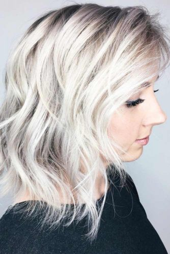 Blonde Hairstyle With Flirty Side Swept Bangs #mediumhairstyles #hairstyles #mediumlengthhairstyles #bangs