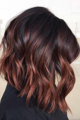 Dark Wavy Angled Long Bob Haircuts With Cherry Red Highlights #bobhaircuts #haircuts #angledbob #longbob #wavyhair