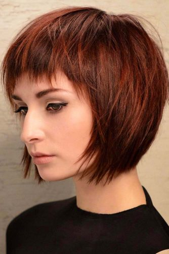 Edgy Auburn Bob With Choppy Baby Bangs #shortbob #shortbobhairstyles #hairstyles #bobhairstyles