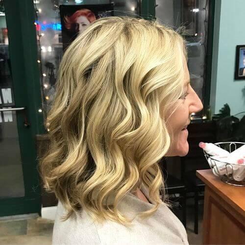 Elegant Curly Medium Length Haircut for Women over 50