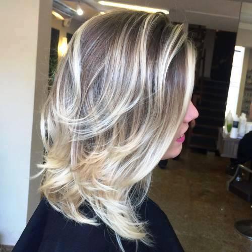 Medium Blonde Feathered Haircut
