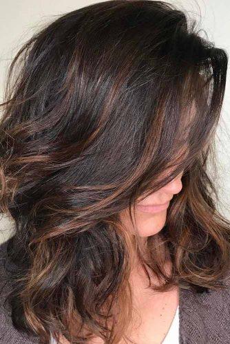 Medium Layered Hair with Side Bang and Highlights