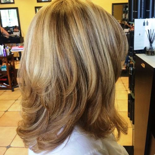 Medium Length Haircut for Women over 50 with some Overlapping Layers
