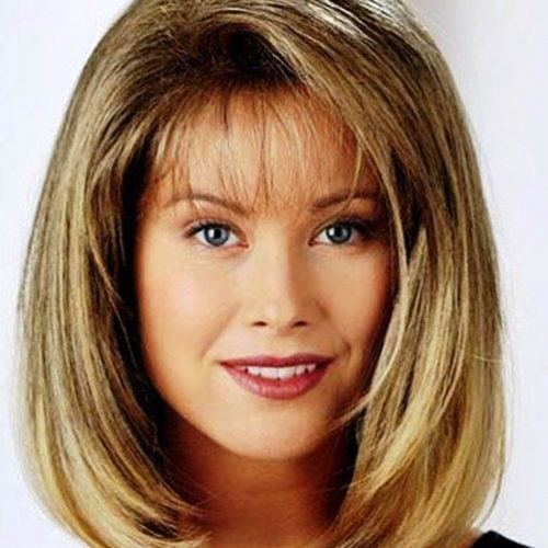 Medium Length Hairstyle with Sweeping Layers: