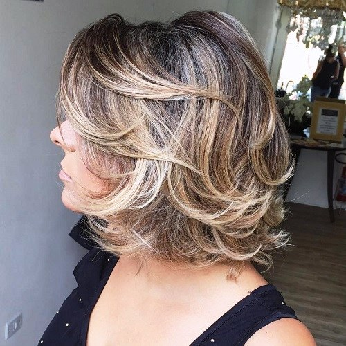 Mid Length Curly Haircut With Bangs