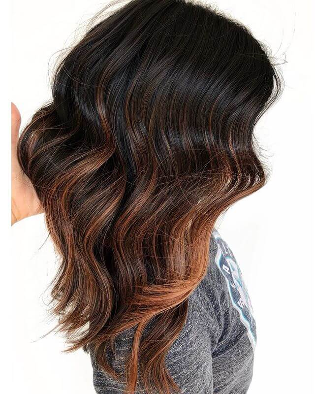 Warmly Toned Waves Of Dark Brown Hair