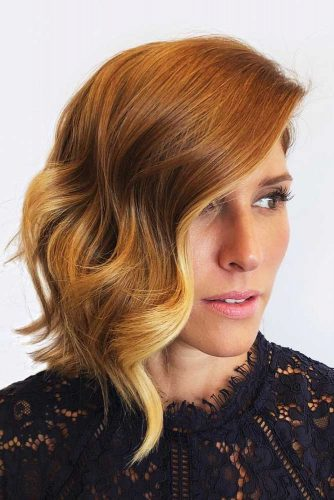 Wavy Asymmetrical Medium Bob With Strawberry Blonde Balayage #bobhaircuts #haircuts #asymmetricalbob #longbob #wavyhair