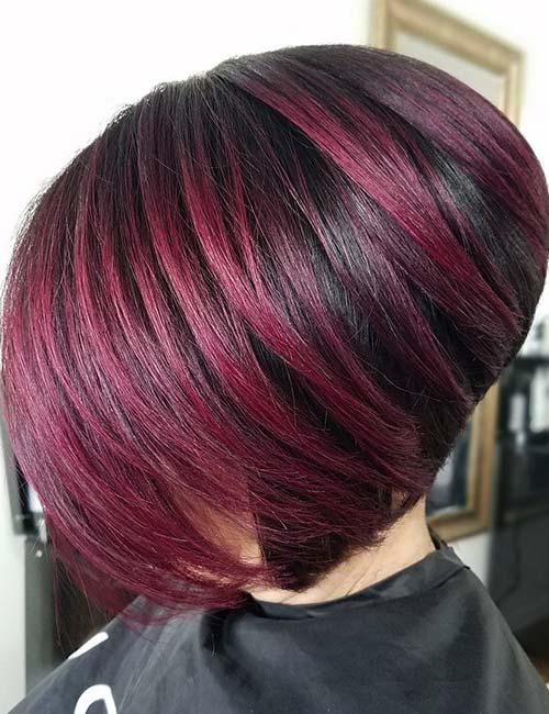 6. Short And Stacked With Purple Highlights