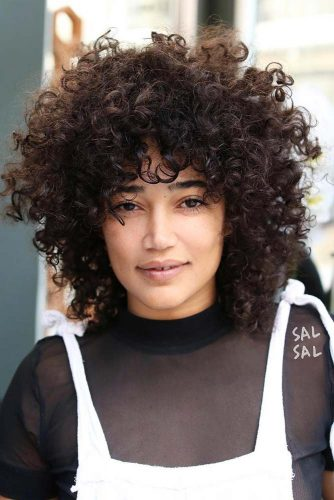 Curly Shag Hairstyle #shaghairstyles #shaghaircuts #mediumlength #hairstyles #curlyhair