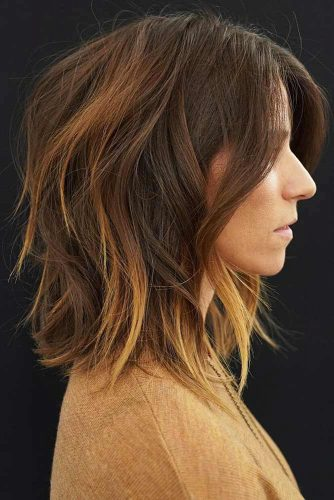 Feathered Brunette Shag With Long Side Bangs #mediumhair #bangs #shaggy