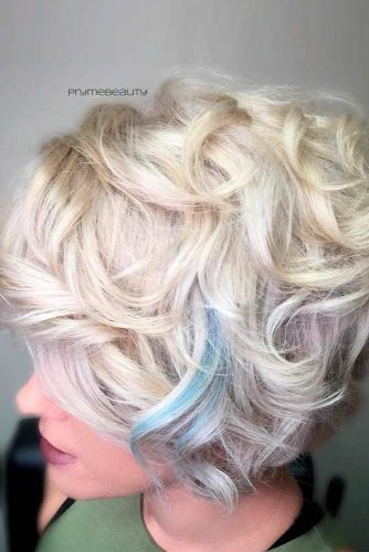 Feminine Curls With Blue Accent #blondehair #curlyhairstyles