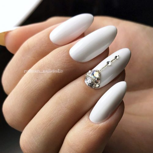 Glamorous White Nails Design With A Half Moon Accent #halfmoonaccent