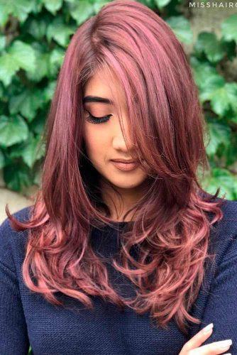 Layered Haircut with Long Asymmetric Bang
