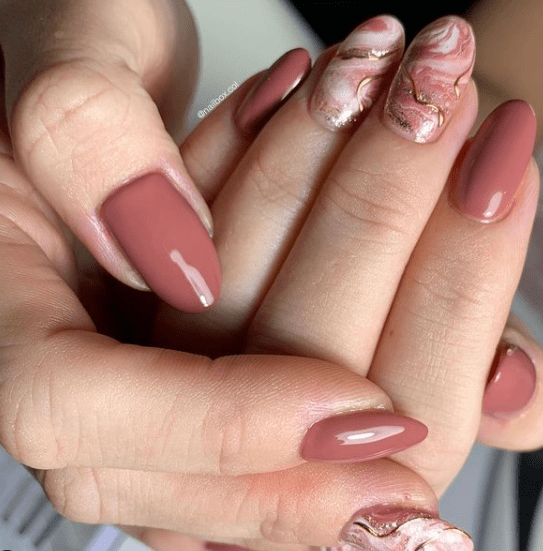 warm-pink-marble-christmas-nail-designs
