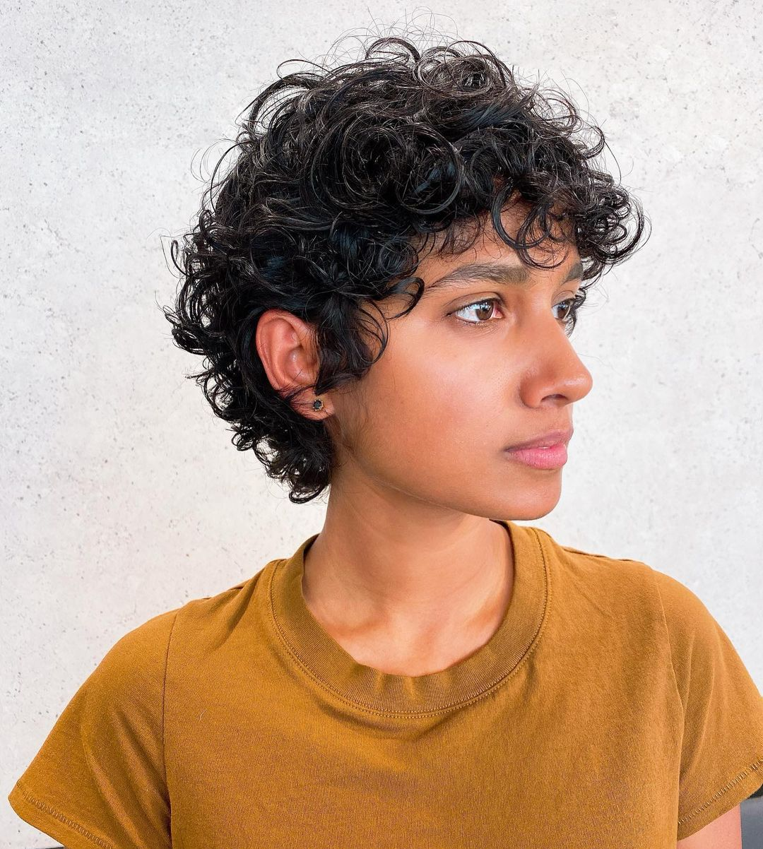 Curly Pixie Haircut with Bangs