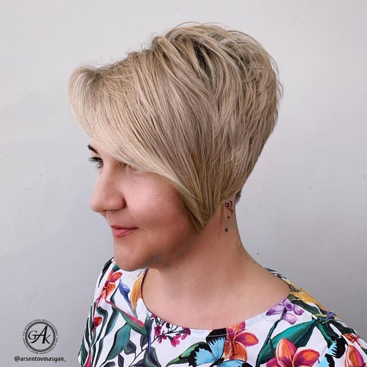 Stacked pixie with long side bangs